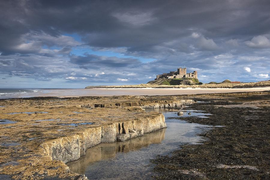 Northumberland Photograph - A View Of Bamburgh Castle Bamburgh by John Short