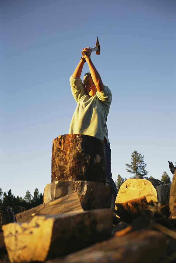 Black Hills Photograph - A Woman Chops Wood With by Bobby Model