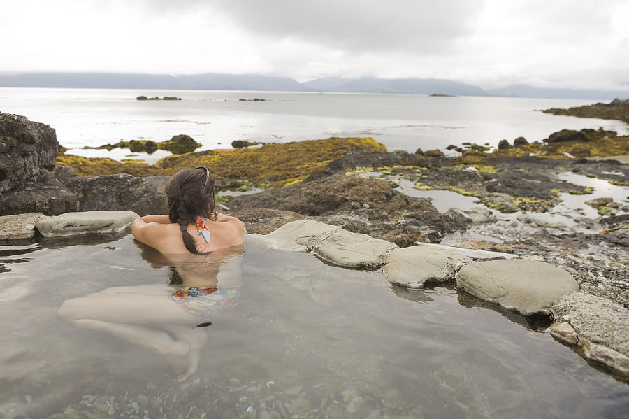 Queen Charlotte Islands Photograph - A Woman Enjoys A Hot Spring by Taylor S. Kennedy