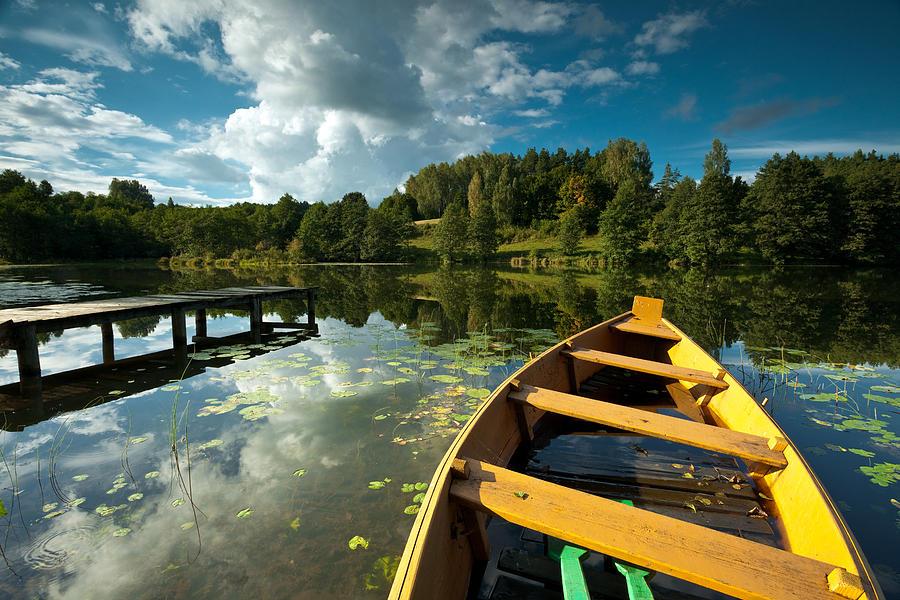 Horizontal Photograph - A Wooden Boat On A Lake In Suwalki Lake District by Slawek Staszczuk