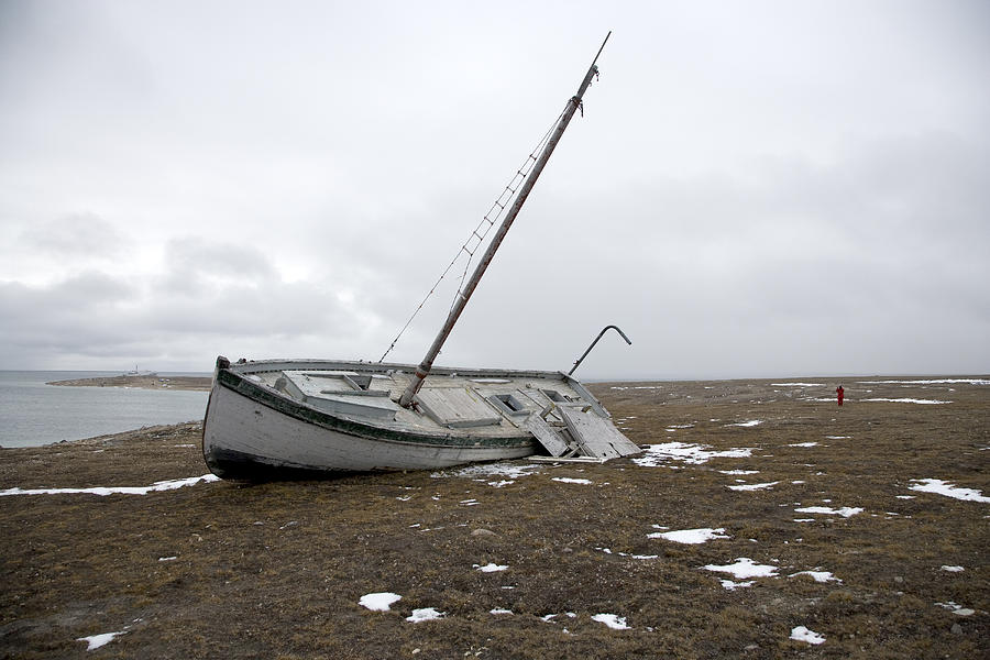 A Wooden Sailboat Is Beached Photograph by Pete Ryan