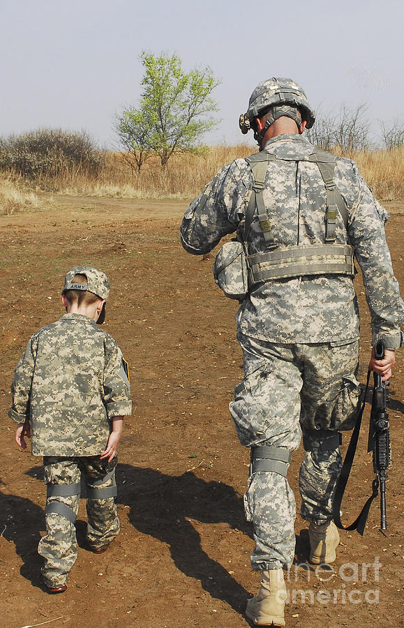 Boys Photograph - A Young Boy Joins His Squad Leader by Stocktrek Images