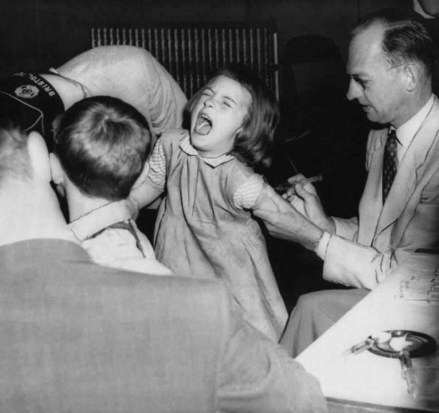 1950s Photograph - A Young Girl Receiving A Vaccine by Everett