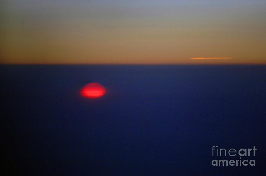 Sunset Photograph - Above The Sunset by Gib Martinez