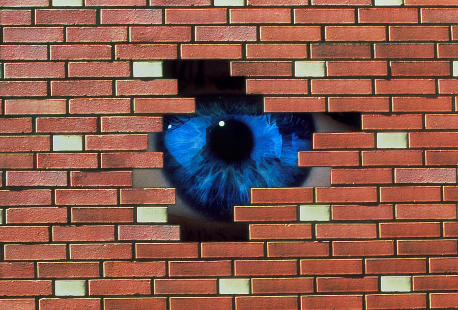 Agoraphobia Photograph - Abstract Of Eye Looking Through Hole In Brick Wall by Mehau Kulyk