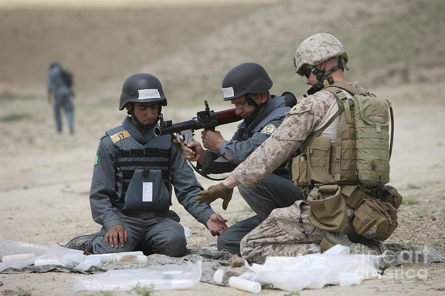 Soldier Photograph - Afghan Police Students Assemble A Rpg-7 by Terry Moore