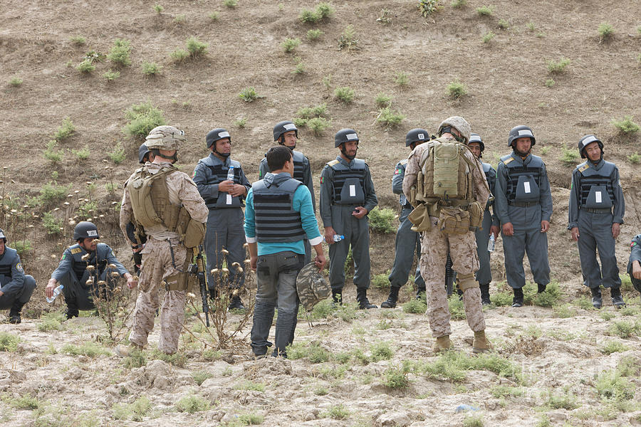 Us Marines Photograph - Afghan Police Students Listen To U.s by Terry Moore