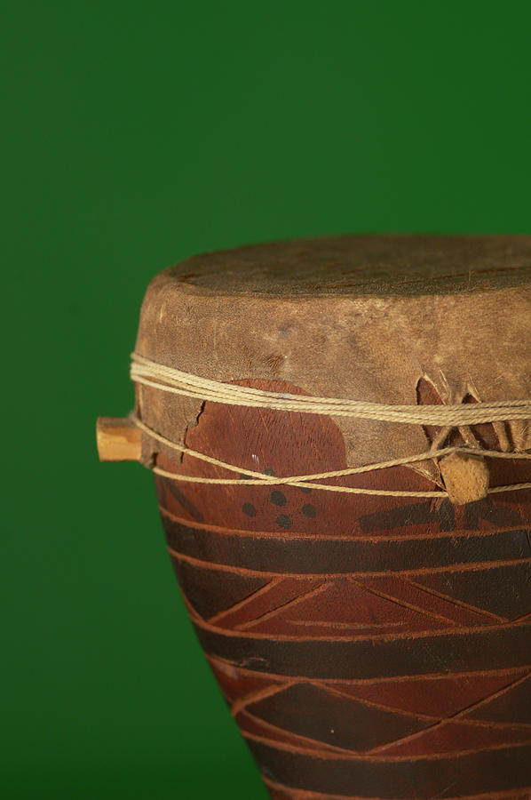 Vertical Photograph - African Drum On Green Backgound by Philip Haynes
