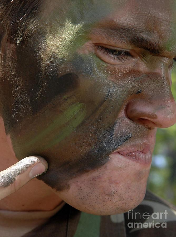 Airman Photograph - Airman Applies War Paint To His Face by Stocktrek Images