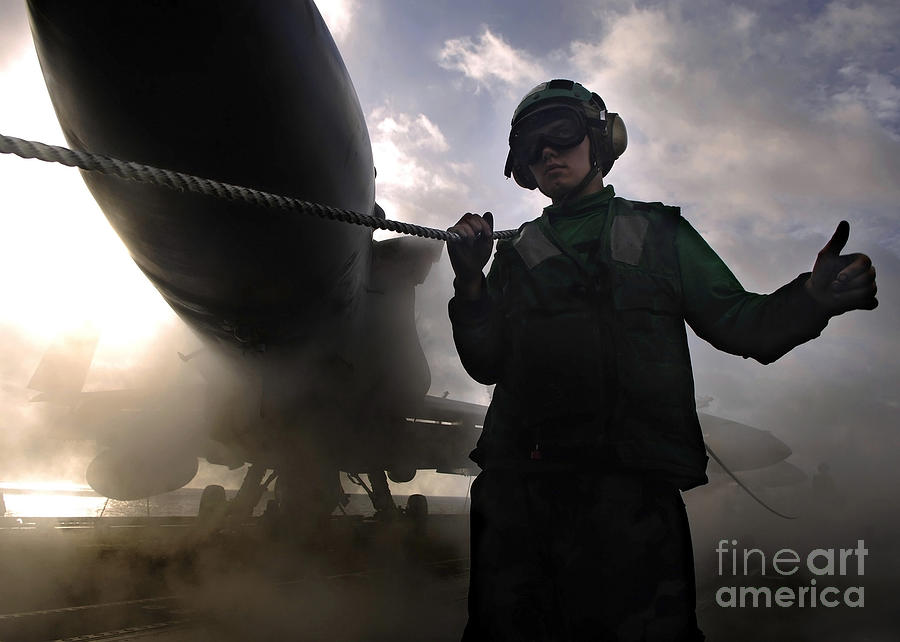 Horizontal Photograph - Airman Holds Up The Safety Shot Line by Stocktrek Images