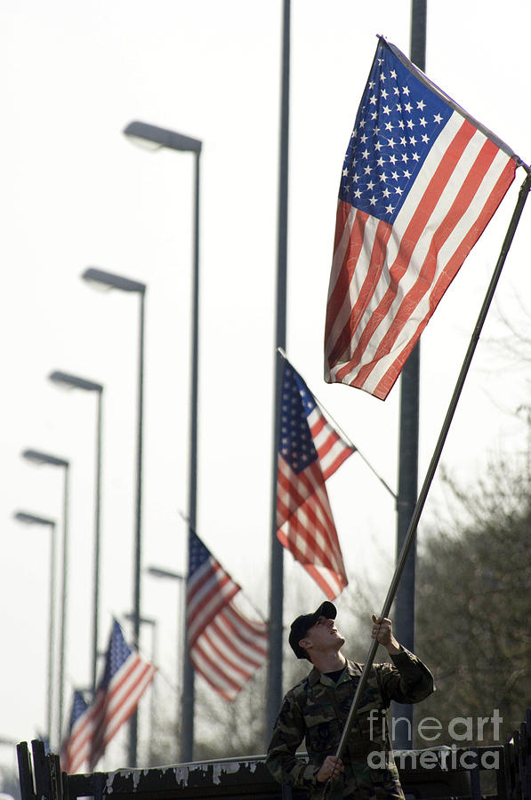 Vertical Photograph - Airman Posts A New Flag On The Main by Stocktrek Images