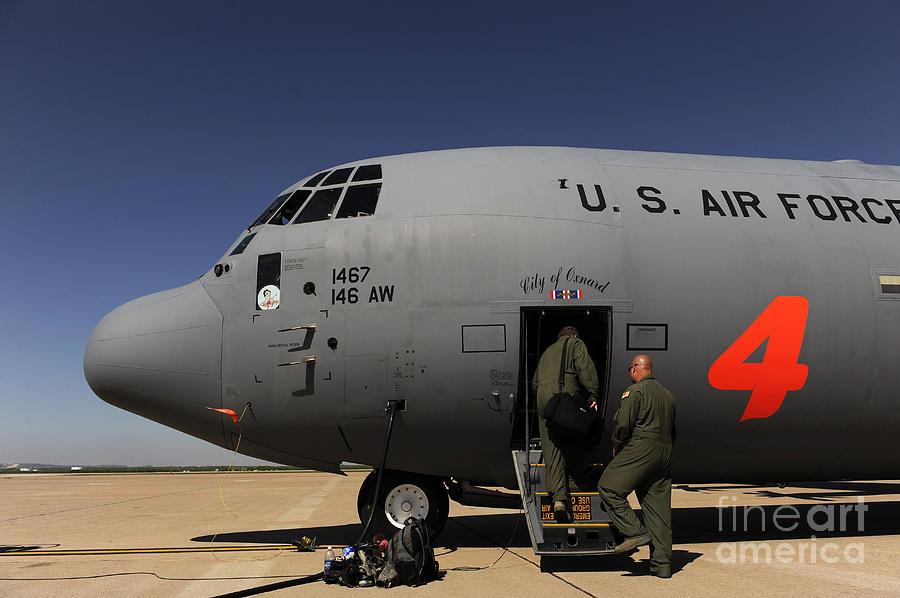 Texas Photograph - Airmen Board A C-130j Hercules At Dyess by Stocktrek Images