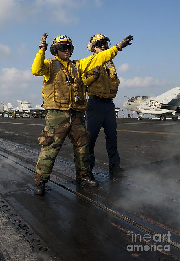 Warship Photograph - Airmen Direct An Fa-18c Hornet by Stocktrek Images
