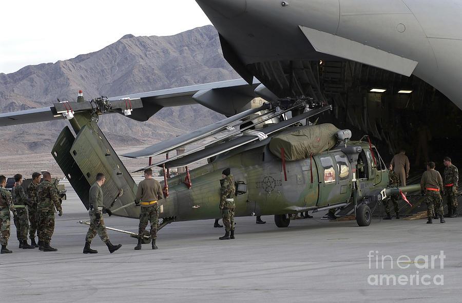 Color Image Photograph - Airmen Load An Hh-60 Pave Hawk by Stocktrek Images