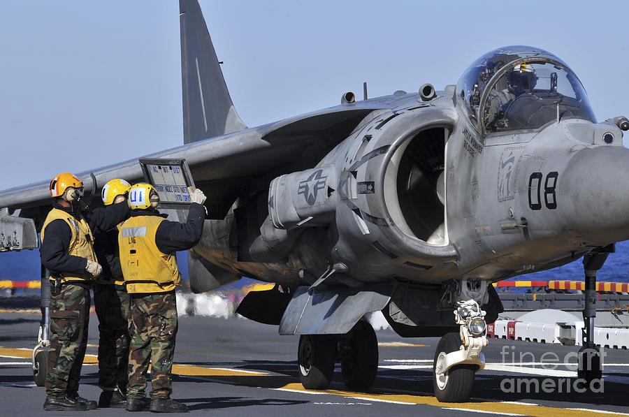 Airmen Show Flight Information To An Photograph