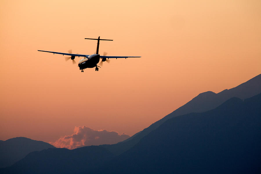 Sunset Photograph - Airplane Landing At Sunset On The Summer Solstice by Ian Middleton