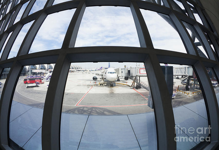 Air Travel Photograph - Airplane Parked At Gate by Don Mason