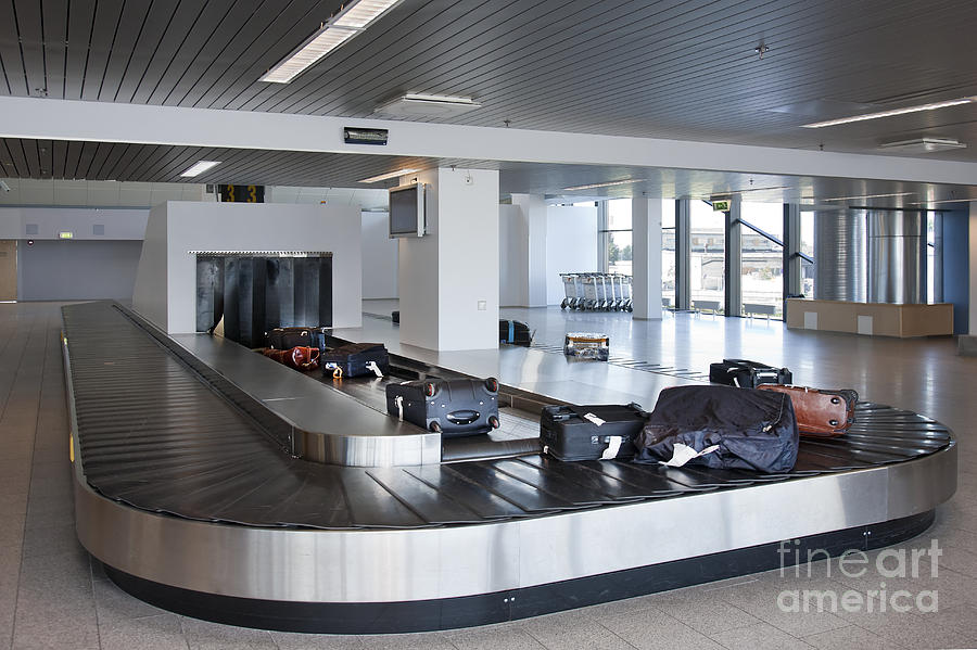 Air Travel Photograph - Airport Baggage Claim by Jaak Nilson
