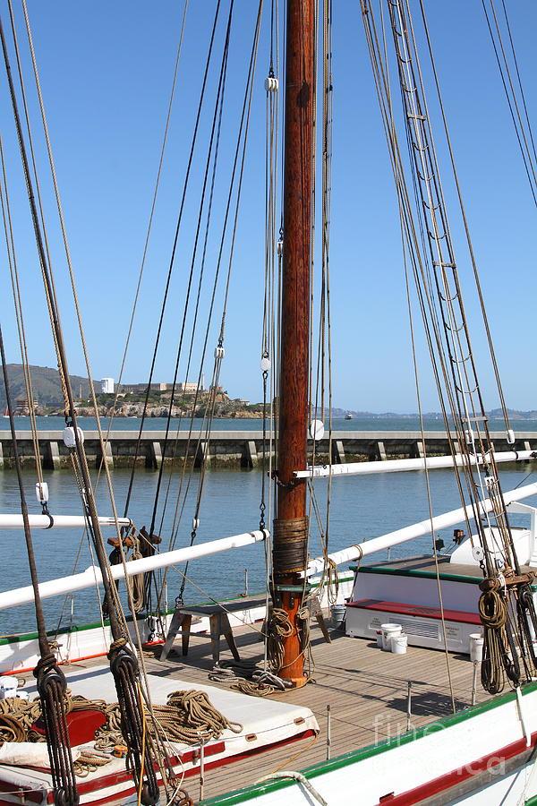 San Francisco Photograph - Alcatraz Island Through The Hyde Street Pier In San Francisco California . 7d14147 by Wingsdomain Art and Photography