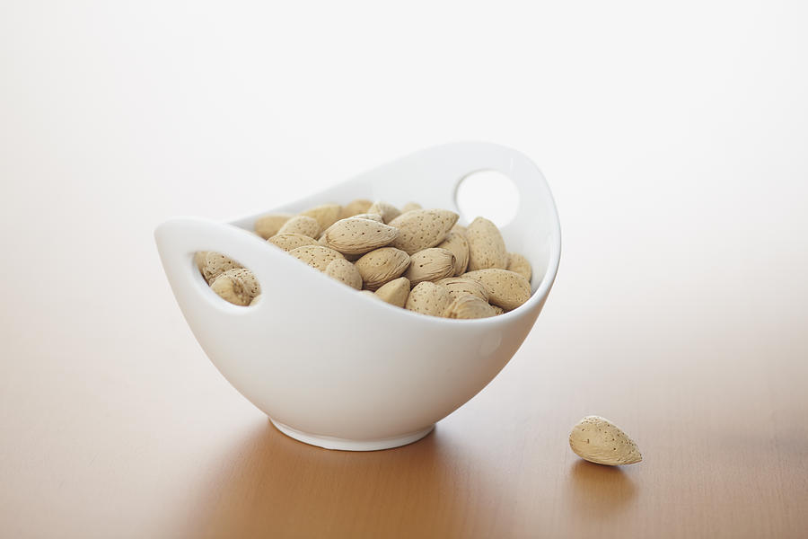 Horizontal Photograph - Almonds In Bowl by Bruce Law