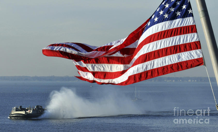American Flag Blowing In The Wind Photograph By Stocktrek