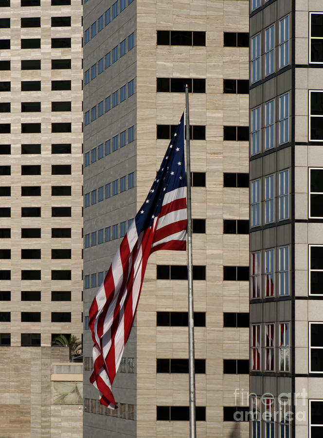 American Flag Photograph - American Flag In The City by Blink Images