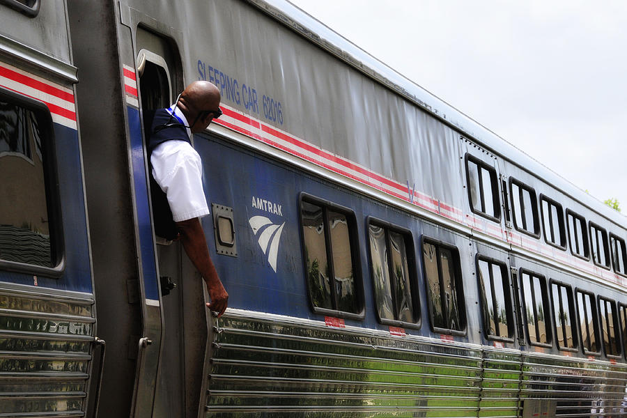 Amtrak Conductor by Lyle  Huisken