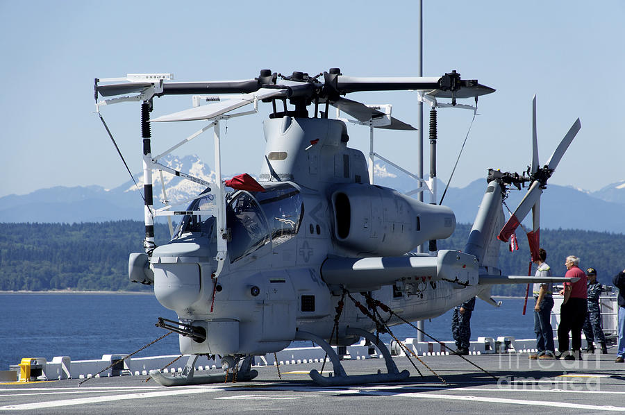 Uss Bonhomme Richard Photograph - An Ah-1w Cobra Is Chained To The Flight by Stocktrek Images