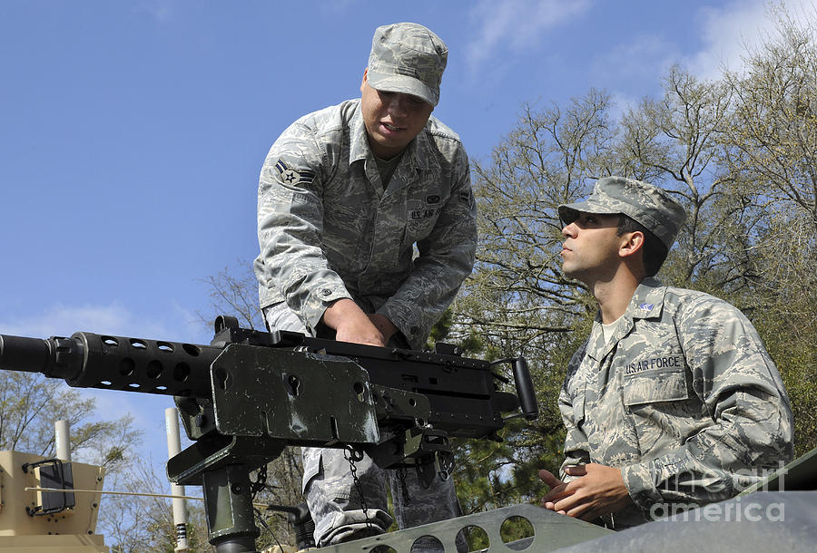 Military Photograph - An Airman Instructs A Cadet On How by Stocktrek Images