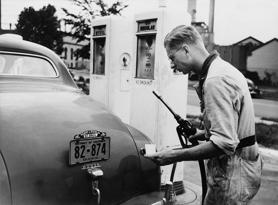 History Photograph - An Automobile Service Station Attendant by Everett