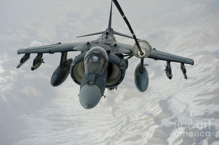 Military Photograph - An Av-8b Harrier Receives Fuel by Stocktrek Images