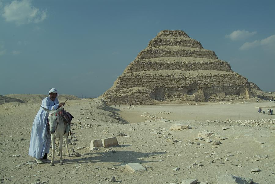 Antiquities And Artifacts Photograph - An Egyptian Man And Donkey At The Step by Richard Nowitz
