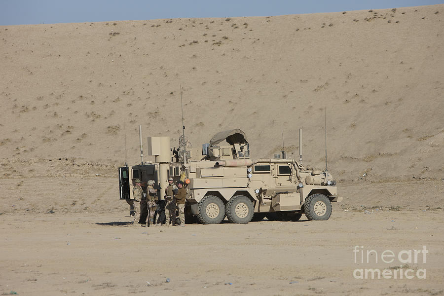 Explosive Ordnance Disposal Photograph - An Eod Cougar Mrap In A Wadi by Terry Moore