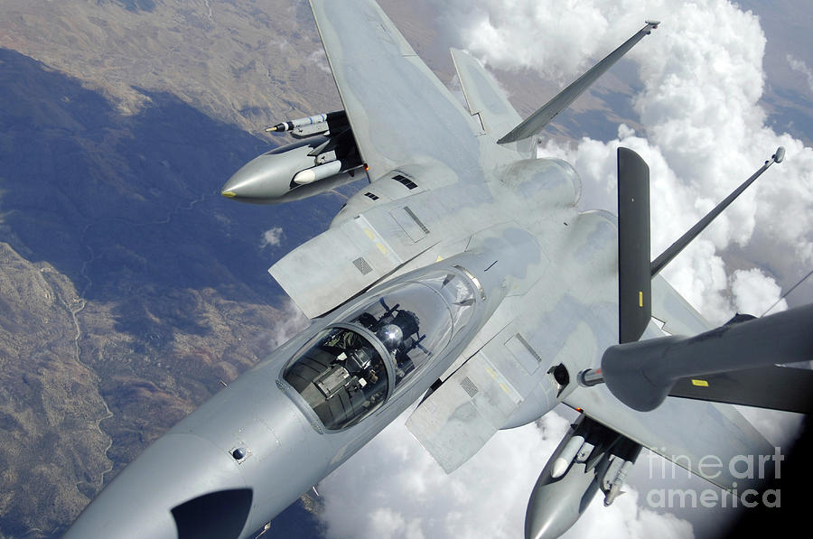 Horizontal Photograph - An F-15 Eagle Pulls Away From A Kc-135 by Stocktrek Images
