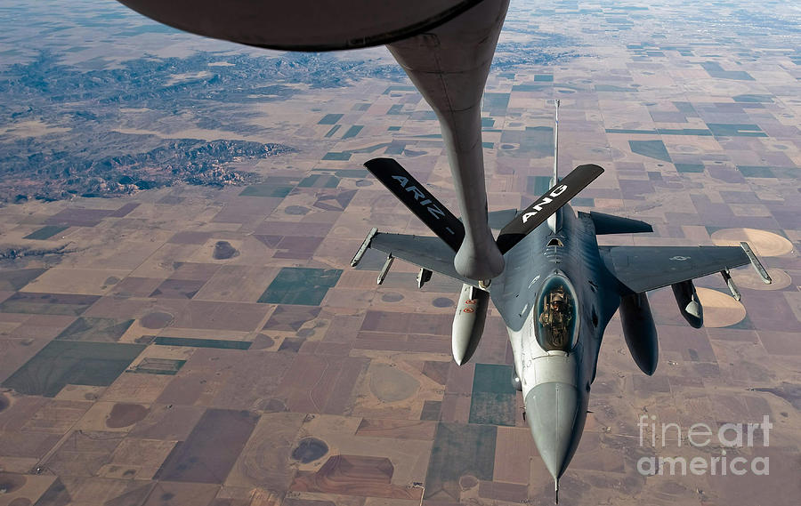 Air To Air Photograph - An F-16 Fighting Falcon Moves by Stocktrek Images