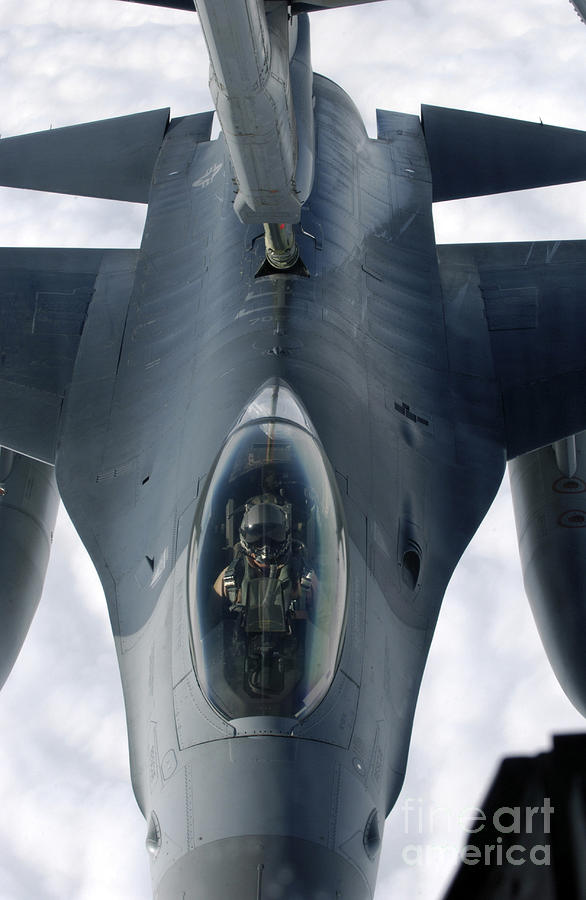 Vertical Photograph - An F-16 Fighting Falcon Receives Fuel by Stocktrek Images