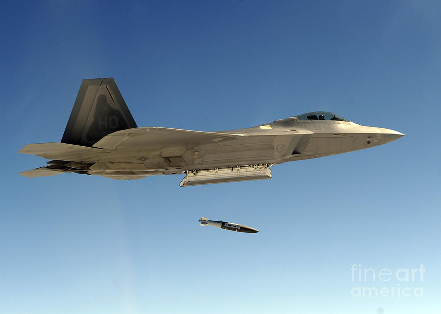 Dropping Photograph - An F-22a Raptor Drops A Gbu-32 Bomb by Stocktrek Images