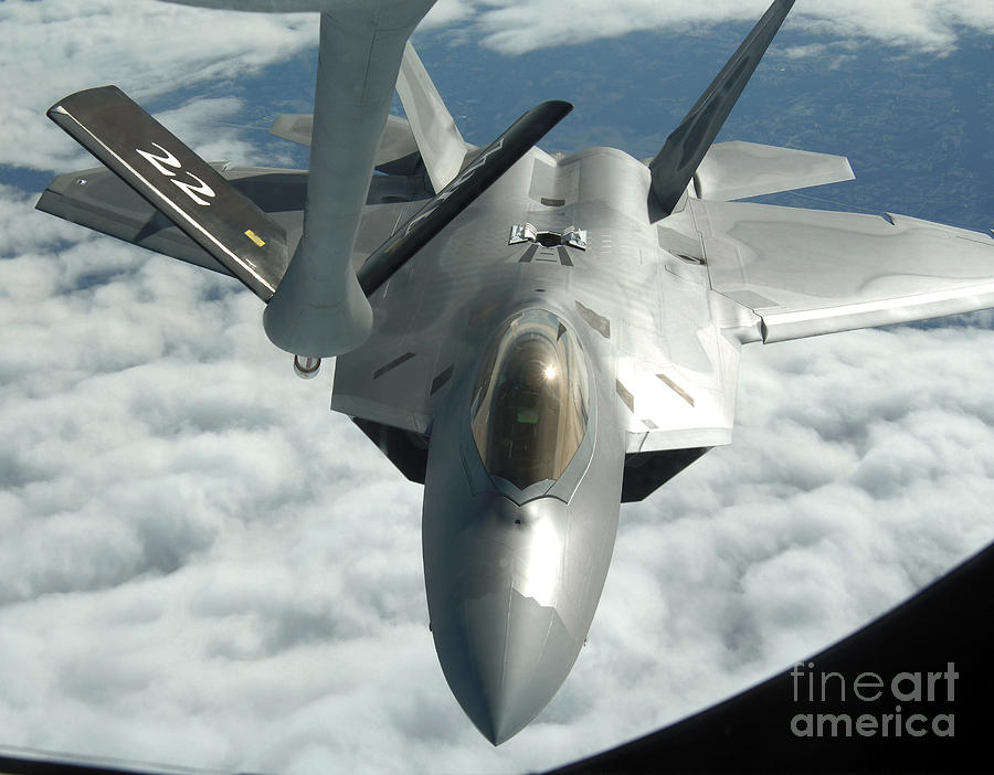 Color Image Photograph - An F-22a Raptor Refuels With A Kc-135 by Stocktrek Images