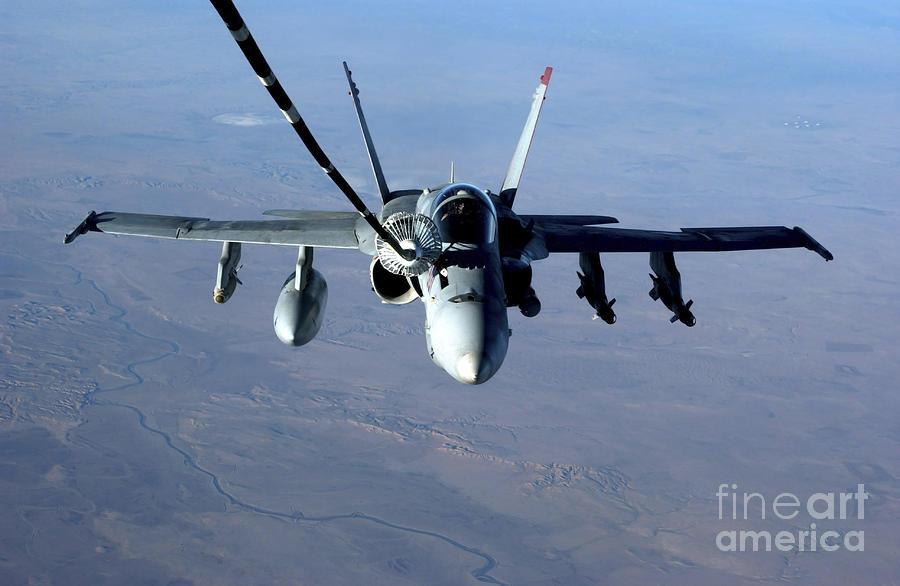 Color Image Photograph - An Fa-18c Hornet Receives Fuel by Stocktrek Images