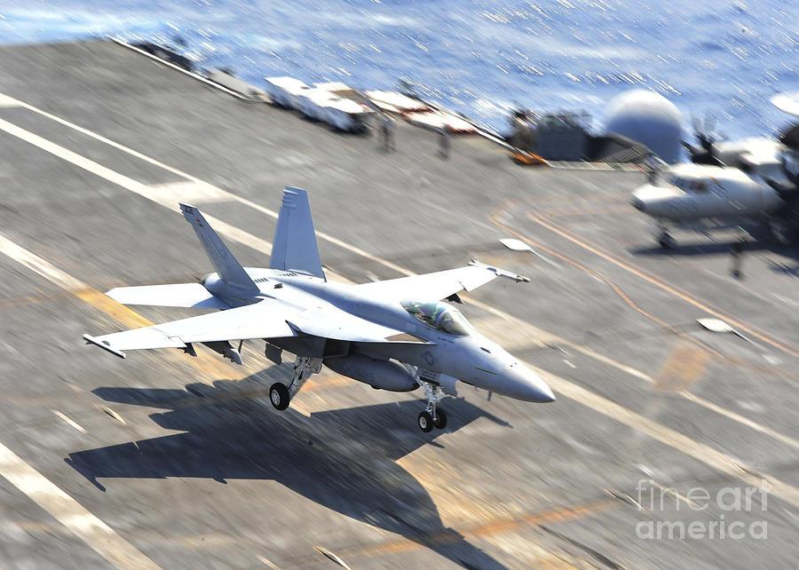 Aircraft Carrier Photograph - An Fa-18e Super Hornet Lands Aboard by Stocktrek Images