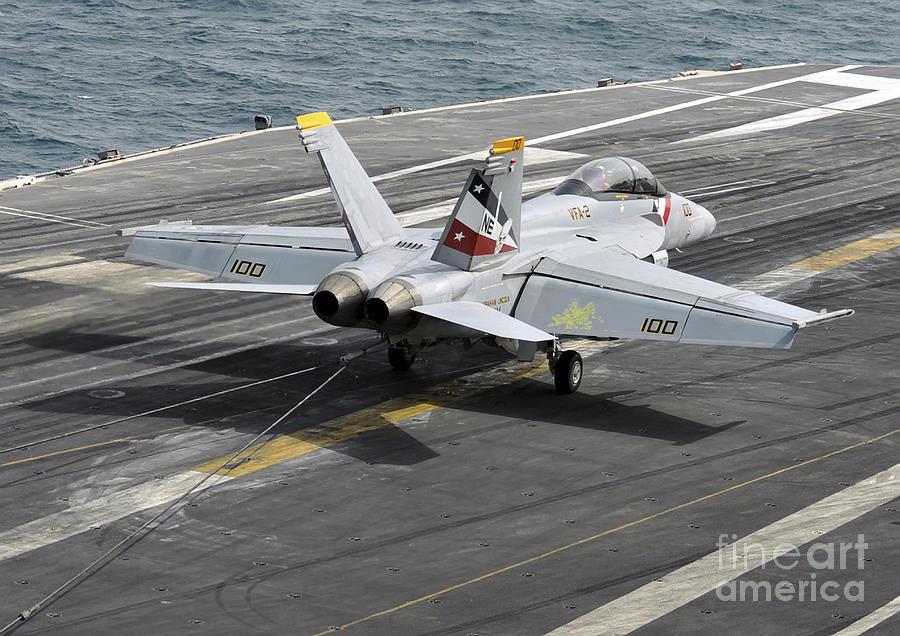 Us Navy Photograph - An Fa-18f Super Hornet Traps An by Stocktrek Images