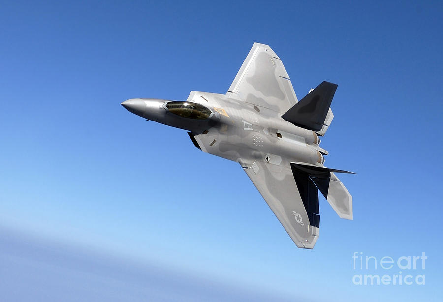 An Fa-22 Raptor Banks During A Training Photograph
