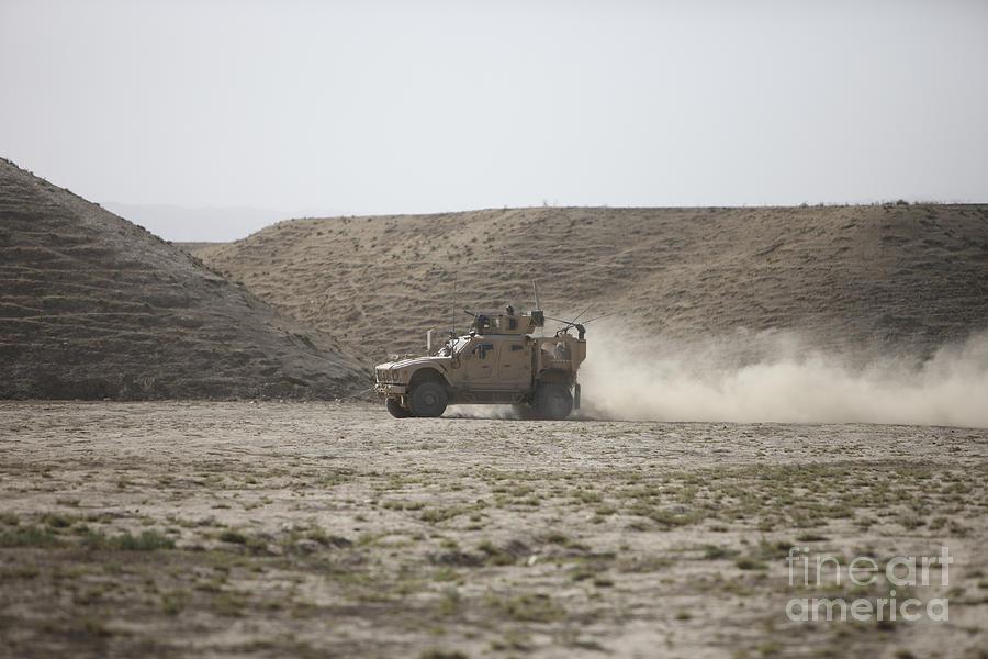 Kunduz Photograph - An M-atv Races Across The Wadi by Terry Moore