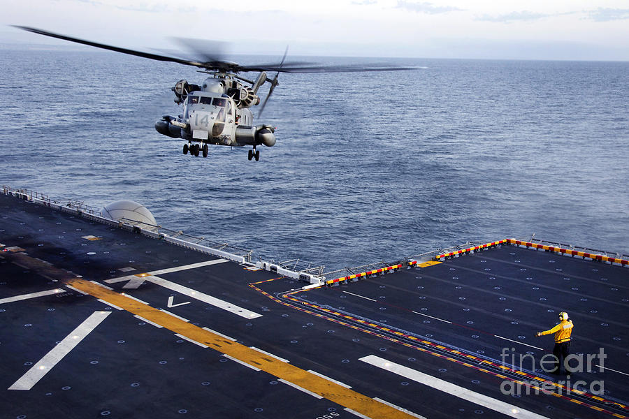 Pacific Ocean Photograph - An Mh-53e Sea Dragon Prepares To Land by Stocktrek Images