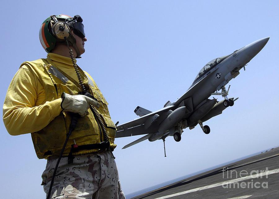 Horizontal Photograph - An Officer Observes An Fa-18f Super by Stocktrek Images