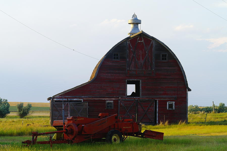 Barns Photograph - an old barn and bailor in Eastern Montana by Jeff Swan
