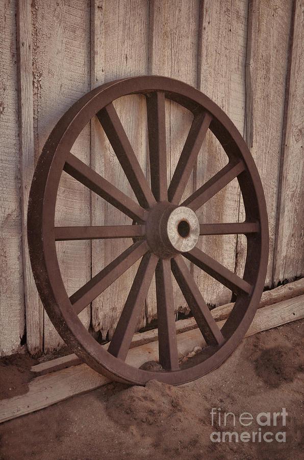 Old Photograph - An Old Wagon Wheel by Donna Greene