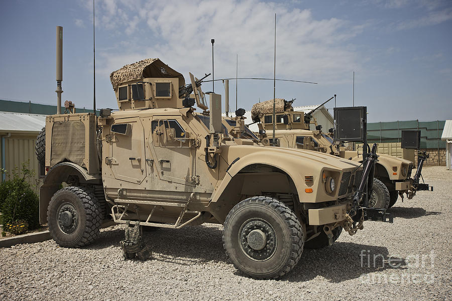 Afghanistan Photograph - An Oshkosh M-atv Parked At A Military by Terry Moore