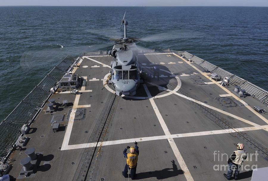 Uss Forrest Sherman Photograph - An Sh-60b Sea Hawk Lands On The Flight by Stocktrek Images