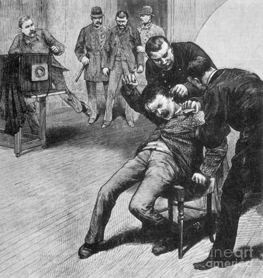 History Photograph - Anarchist Being Held Down For Mug Shot by Photo Researchers